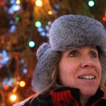 My mom in front of the christmas tree